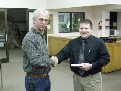 Washington Tree Beautification Committee Member Rick Wagenknecht (left) presents KCII's Adam Welker with his organization's Volunteer of the Year Award at the 3/3/10 City Council meeting