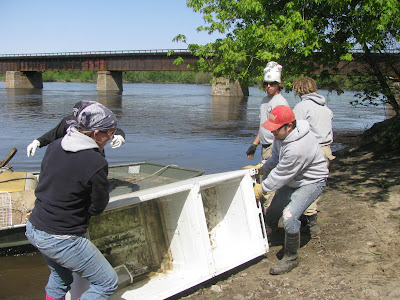 Volunteers haul junk off the banks of the Iowa River (Photo Submitted)
