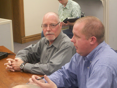 Kalona City Administrator Ryan Schlabaugh (right) and City Councilor Steve Lafaurie lobby superivors for a $20,000 grant for downtown revitalization during the 11-10-09 meeting (KCII NEWS)