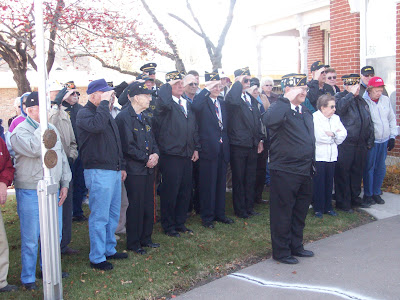 Veterans salute the Flag during Taps at the Blair House on Veterans Day (11/11/09 - KCII News)