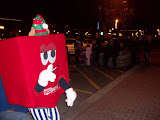 A gift from U.S. Bank walks during the 15th Annual Holiday Lighted Parade in Downtown Washington (KCII NEWS)