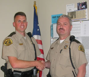 Sheriff Jerry Dunbar (Right) welcomes Chad Ellis to the Department in 2005 (Photo Courtesy of Washington County Sheriff's Office)