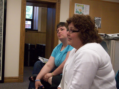 Attorneys Julie Gilmere (Front) and Patricia Lipski express concern over the DHS restructuring at the Washington County Board of Supervisors Meeting