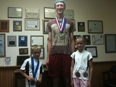 Iowa Games Medalist Cole Anderson (Washington) , Joseph Altmaier (Riverside), and Hannah Anderson (Washington).