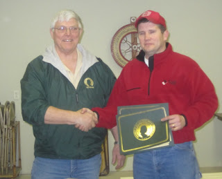 Izaak Walton League of America's National Director for Iowa Marion Streigel (left) presenting award to Jeb Grimm