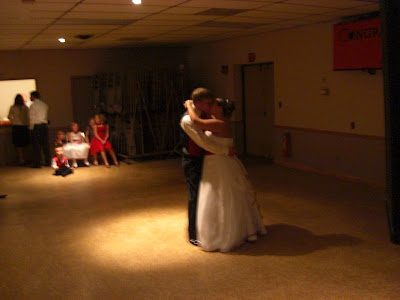 John and Mellisa stealing a kiss during the first dance