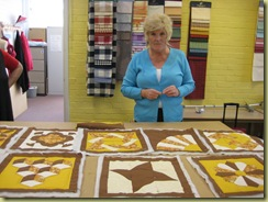 Pam with some of her blocks, almost ready to  start sewing them together