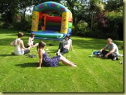 having fun with the bouncey castle