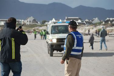 Whales beach in Kommetjie, Cape Town, South Africa. Police come to close the beach.