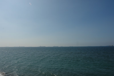 Cargo ships lining up to enter Kaohsiung Port, as seen from Cijin Island.