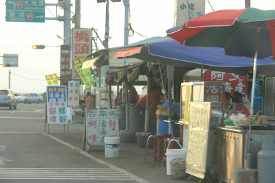 Turn right and you are onto Route 61, northbound. The stalls sell sea food and oyster snack.