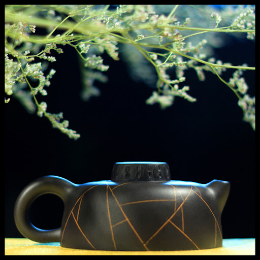 Your Black Web Chinese teapot crafted in the famous town of Yixing
