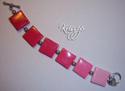 Pulsera cuadraditos rosas