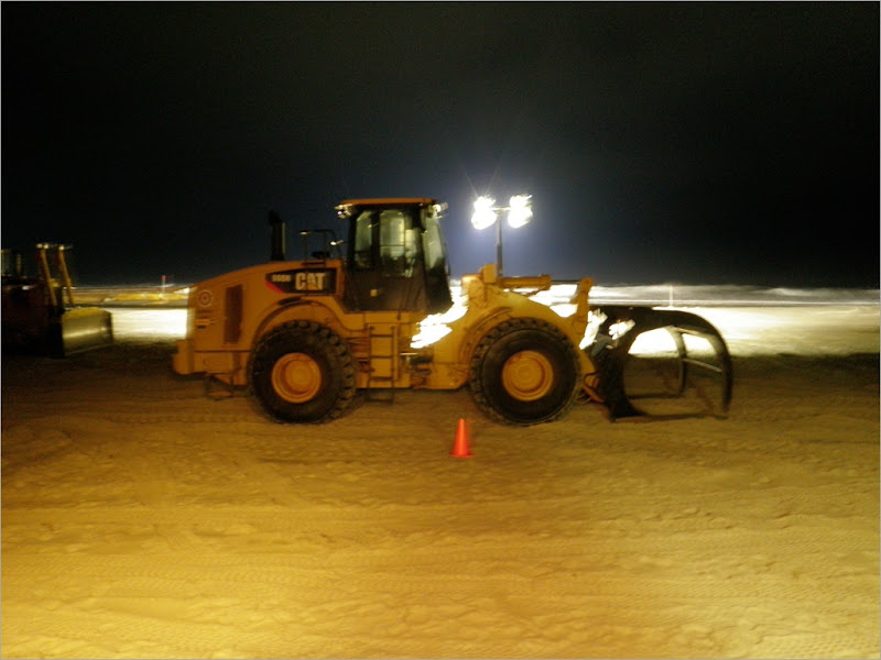 This how they moved the pip around the beach. The piece of equipment is called a loader.