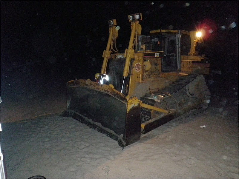 A dozer used to move the sand around the beach. the specs that you see here is the flying sand that was a constent irritent during my first week here.