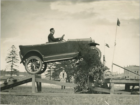 94/268/1-1/16 Photographic print, black and white, Overland car jumping a 'fallen bridge' in a promotional stunt, typed caption verso, Sam J. Hood, photographer, Australia, mid 1920s (Front)