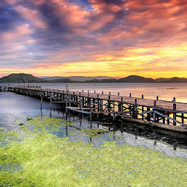 Sunset In Sentani Lake by Geoffrey Saturnus - Landscapes Sunsets & Sunrises