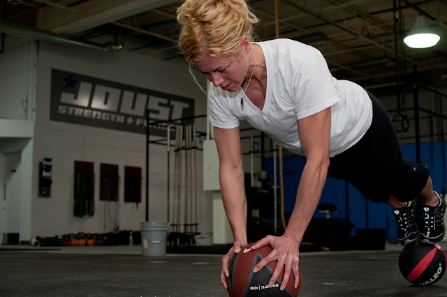 Jes does the two ball pushup