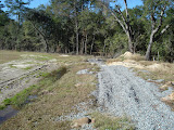 A typical closed landfill requires continuous maintenance. Here bare areas are photographed and reseeding is recommended to the owner along with improving drainage to prevent ponding of water.