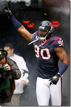 28 DEC 2008: Houston Texans defensive end Mario Williams #90 is introduced to the crowd during a football game between the Chicago Bears  and the Houston Texans Dec 28, 2008 at Reliant Stadium in Houston, Texas.