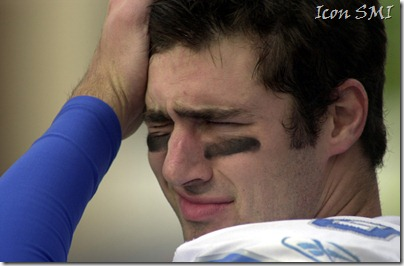 The Lions' Joey Harrington wipes his brow during a loss to the Chicago Bears.