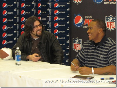 Jahvid Best talks with Ty of The Lions in Winter, and his BlackBerry, at a Pepsi Max event.
