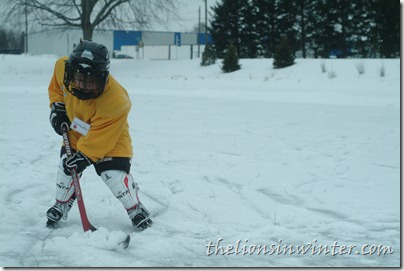 My boy playing hockey on the pond. Yes, it needed to be shoveled.