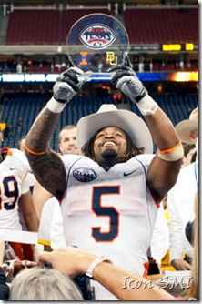 27 December 2010; 2010 Texas Bowl- Baylor Bears v Illinois Fighting Illini; Illinois Fighting Illini running back Mikel Leshoure (5) hoists his MVP trophy after the game; Illinois won 38-14