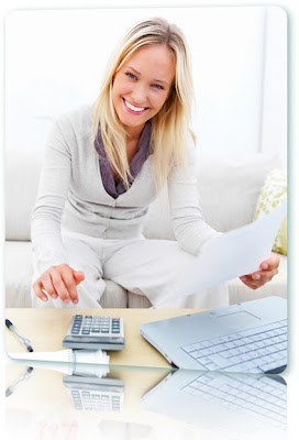 Blond woman using a laptop and calculator to budget with payday loans online.