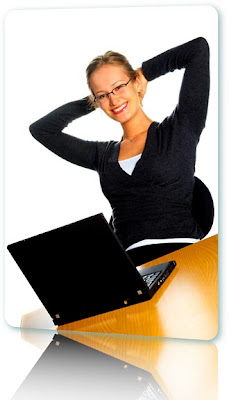 Blonde woman leaning back in her chair smiling in front of a black laptop.