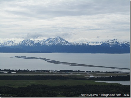 Homer, Alaska - the airport in the foreground and the Homer Spit stretching out toward the Aleutian Mountains.