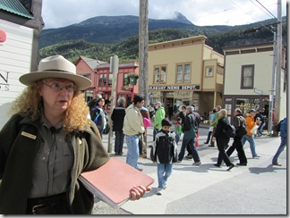 This is Ranger Green in the midst of telling us about the people who built a cigar business, the local Skagway News and the Skagway Saloon.  Those three buildings across the street are the original sites.