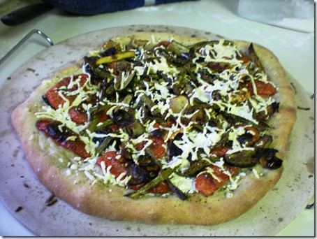 New best pizza ever! Oven roasted onions, asparagus, zucchini, crook-necked squash, and tomatoes atop the crust recipe from American Vegan Kitchen sprinkled with Daiya and seasoned with Penzy's pizza sprinkle. oh yeah, you know you're sad you missed it.