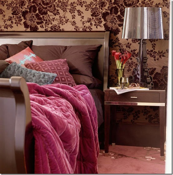 Accessories: glamorous opulent; bedroom; copper/brown floral fabric / wallpaper; embossed cushion, pink/red velvet quilt; sleigh bed; carpet, sidetable, table lamp.   Pub orig    L etc 10/2005 p52