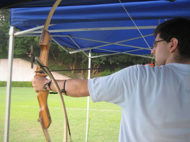 Nima going for the bullseye at the archery range