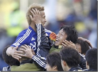 Japan's Keisuke Honda celebrates Winning