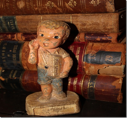 newsboy figurine books behind (2)