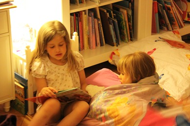 Sophia reading Constance a good night story