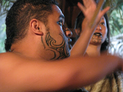 "She says, ""[Here are] two tattooed Maori warriors. Their faces are done with"