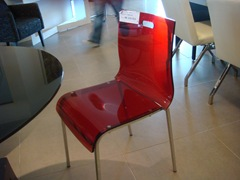 The clear chair in red