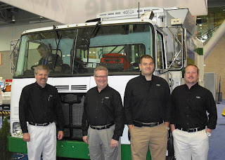 Craig Teune, sales chief Cliff Buck, Jon Loftis and Brian Rhoades of Autocar with CNG-fueled Xpeditor truck with body by Labrie.