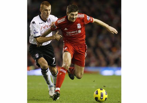 Steven Gerrard in action with Steven Sidwell, Liverpool - Fulham