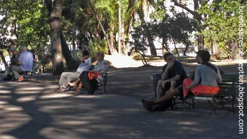 Folks relaxing in the shadow of big trees in the Parque Lezama in San Telmo, Buenos Aires