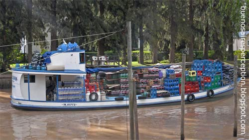Supply Boat crossing the Arroyo Rama Negra, a branch of the Parana Delta in Tigre