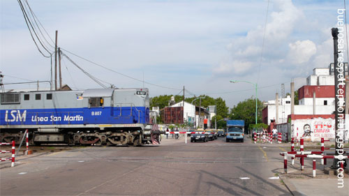 One of the blue trains of Linea San Martin at a railroad crossing in the Palermo neighborhood, Buenos Aires