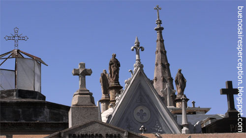 Christian crosses and stone figurines guarding the dead of the aristocrats' cemetery in Recoleta, Buenos Aires