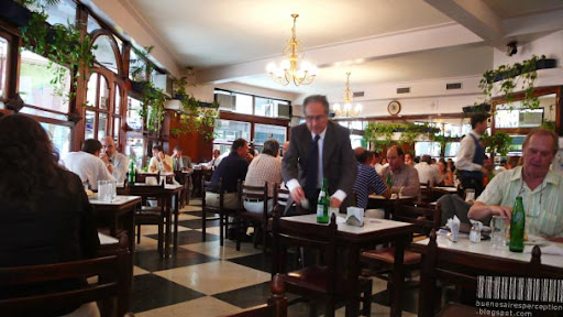 A Man is Paying His Bill in a Café in Downtown Buenos Aires, Argentina