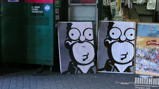 Best-Known All-American Figure: Homer Simpson Posters in front of a Kiosko in Buenos Aires, Argentina