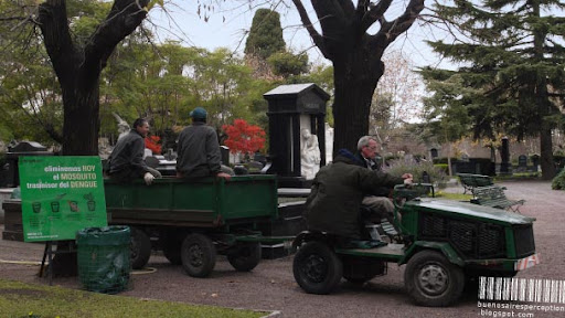 Gardeners on a Small Ride in the La Chacarita Cemetery in Buenos Aires, Argentina