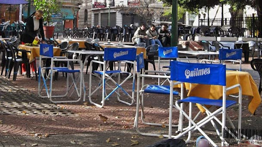 Chairs and Tables of a Restaurant at the Plaza Dorrego advertising Quilmes Beer in Buenos Aires, Argentina
